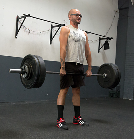 Barbell training exercises like the deadlift build a strong back.