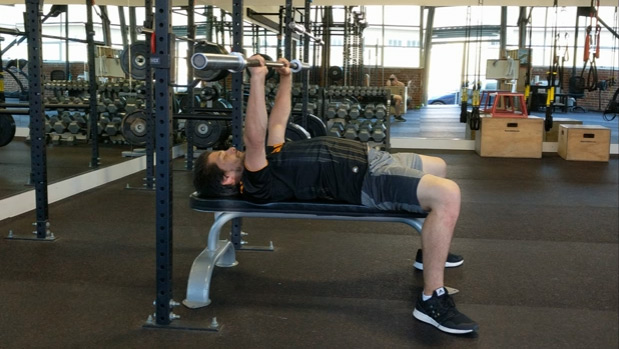 Unracking and racking the bench press